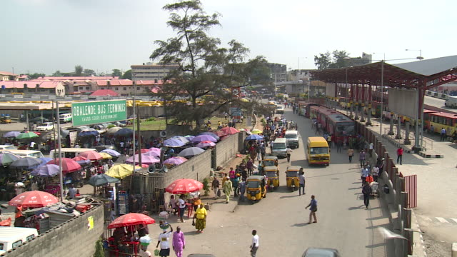 high angle view over bus station in lagos, nigeria - nigeria stock videos & royalty-free footage
