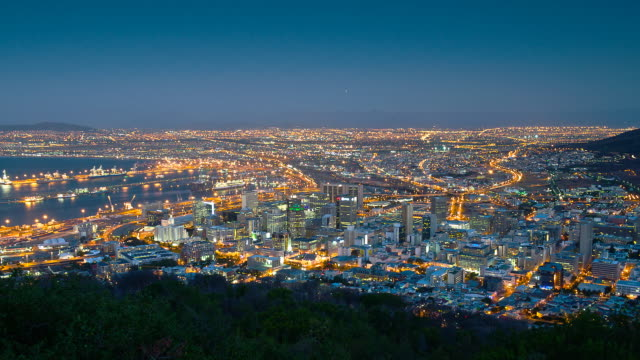 T/L High angle view over Cape Town lighting up as night falls, South Africa