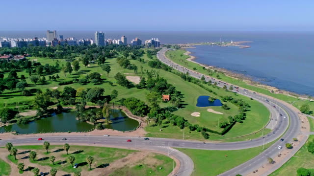 high angle view, paragliding over montevideo's coastline, uruguay - 鎮静薬点の映像素材/bロール
