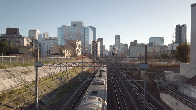4k high angle view . passenger train passing - two objects stock videos & royalty-free footage