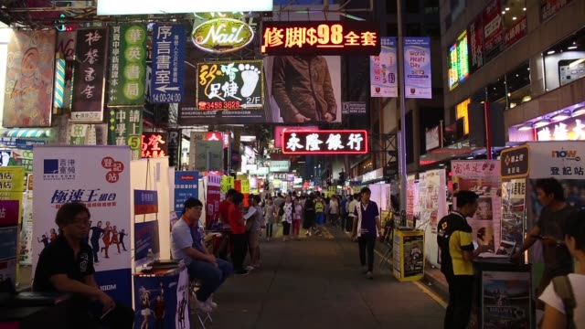 vidéos et rushes de high angle view pedestrians walk along a street in the mong kok area of hong kong china on tuesday oct 1 various general views mong kok shopping area... - mong kok