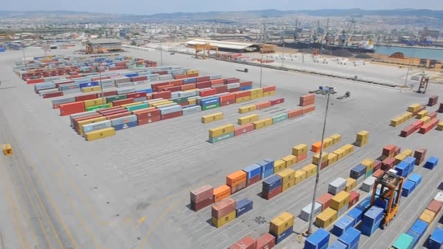 high angle view pan rl shipping containers stand on the dockside at thessaloniki port operated by thessaloniki port authority sa in thessaloniki... - port authority stock videos & royalty-free footage