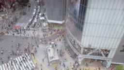 4K high angle view . Shibuya Crossing in Tokyo , Japan