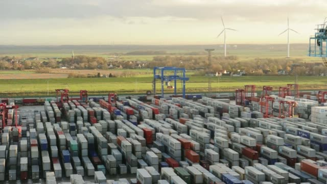 high angle view shipping containers stand stacked on the dockside during loading operations for the maersk mckinney moeller triplee class container... - straddle carrier stock videos & royalty-free footage