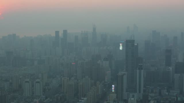 High angle view traffic drives on a city street in Shenzhen China on Thursday Dec 19 High angle skyline view farmland in Hong Kong left sits across...