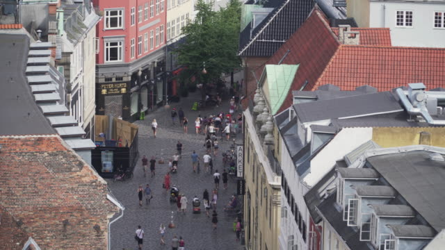 high angle view: traveler in market streets around the round tower in copenhagen, denmark - pedestrian zone stock videos & royalty-free footage