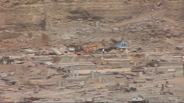 high angle view vast sandstone quarry shots of lorries and trucks in quarry tracking shot through quarry ext rana sengupta interview sot - sandstone stock videos & royalty-free footage