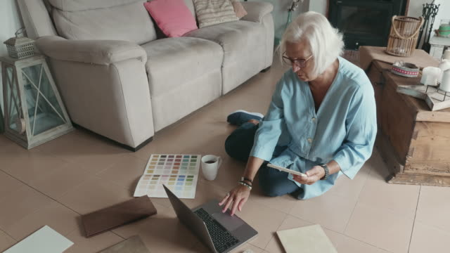 high angle view video of mature woman planning new decor for home - color swatch stock videos & royalty-free footage