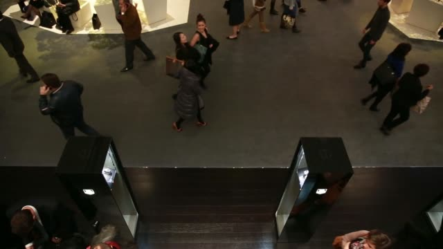 high angle view visitors walk past the bulgari spa display booth, a luxury unit of lvmh moet hennessy louis vuitton sa, during the baselworld luxury... - tradeshow stock videos & royalty-free footage