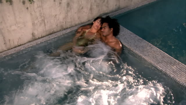 high angle view. young couple relaxing in hot tub. - hot tub stock videos and b-roll footage