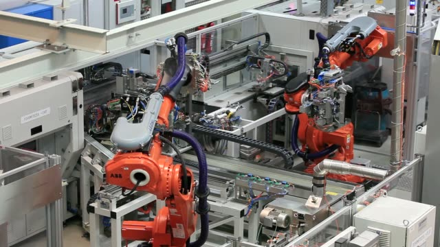 high angle views abb ltd. robotic arms operate in the production of battery modules, manufactured by samsung sdi co, at the bayerische motoren werke... - lithium ion battery stock videos & royalty-free footage