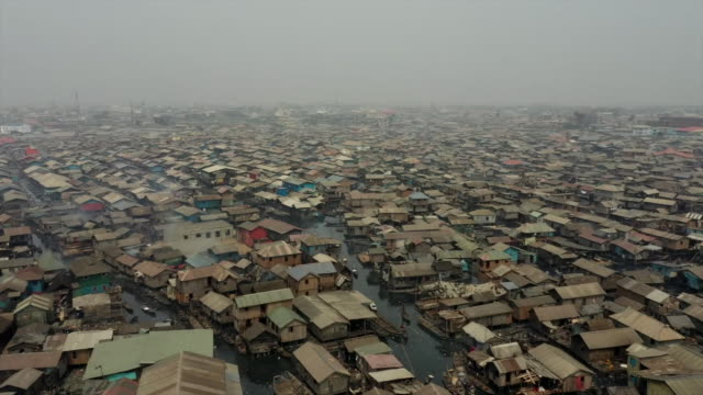 high angle views of a slum in lagos - moving up stock videos & royalty-free footage