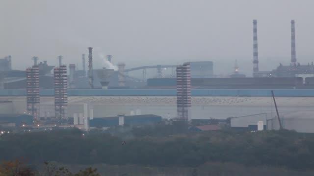 High angle views of chimneys at the Jindal Steel Power Ltd's plant in Raigarh Chhattisgargh India Tuesday Feb 10 Exteriors of Blast Furnace trucks...