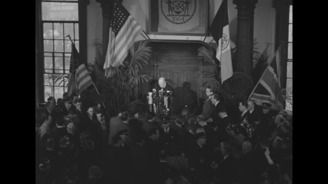 stockvideo's en b-roll-footage met ls high angle views of crowded room as former british prime minister winston churchill takes podium and gives twofinger victory sign us british and... - 1946