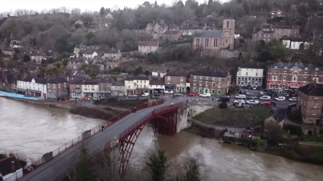 high angle views of the flooded river severn in shropshire - ironbridge shropshire stock videos & royalty-free footage