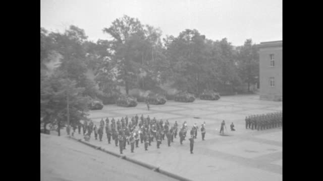 high angle views of the large courtyard of the barracks with two rows of soldiers facing each other as the american flag is slowly raised above the... - soviet military stock videos & royalty-free footage