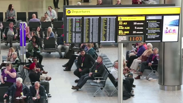stockvideo's en b-roll-footage met high angle views the airport departures hall during a test day ahead of opening at heathrow airports new terminal 2 facility in london uk on... - voetgangerspad