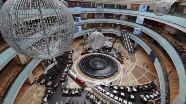 "high angle views visitors are seen in the main hall of the afimall city shopping and entertainment complex at ""moscow city"" business center in... - levi's stock videos & royalty-free footage"