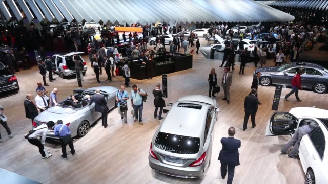 high angle views visitors inspect mercedes benz automobiles on display at the mercedes benz ag stand during the first preview day at the paris motor... - motor show stock videos and b-roll footage