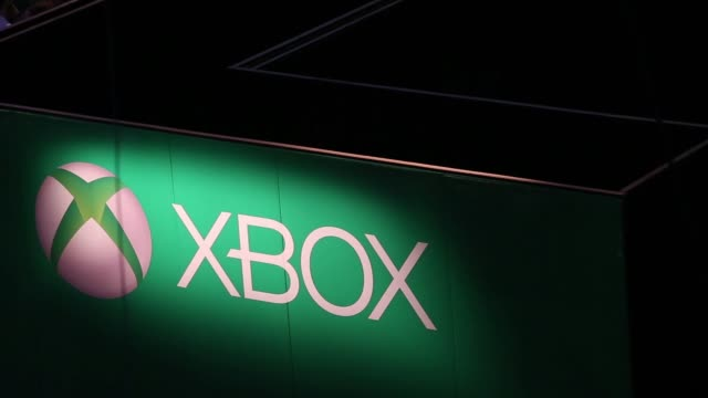 High angle views visitors play video games on Microsoft Corp Xbox consoles during the EGX gaming conference at Earls Court in London UK on Friday...