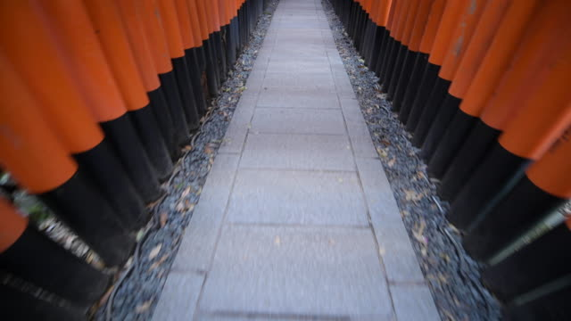high angle, walking through fushimi inari shrine in kyoto - shrine stock videos & royalty-free footage