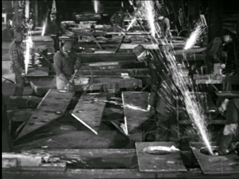 b/w 1943 high angle welders working in defense plant / pennsylvania / industrial - welder stock videos & royalty-free footage