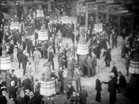 high angle wide shot action starting on floor of new york stock exchange / wall street, nyc / newsreel - 1920 1929 stock-videos und b-roll-filmmaterial