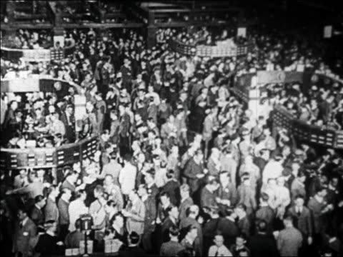 high angle wide shot busy crowd on floor of new york stock exchange / wall street, nyc / newsreel - 1920 1929 stock-videos und b-roll-filmmaterial