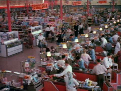 1960 high angle wide shot pan busy crowded grocery store / industrial - 1960 stock-videos und b-roll-filmmaterial