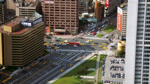 High angle wide shot busy intersection as viewed from Taipei 101 building / Taipei, Taiwan