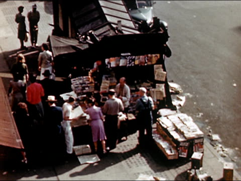 1945 high angle wide shot busy newsstand on new york city street/ audio - 1945 stock videos and b-roll footage