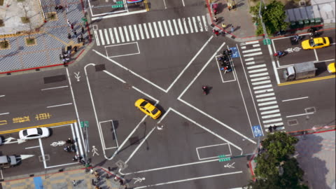 high angle wide shot center of busy intersection as viewed from taipei 101 building / taipei, taiwan - taipei stock videos & royalty-free footage