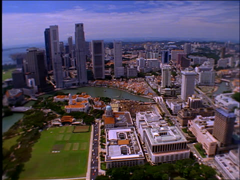 high angle wide shot pan of city of singapore - anno 1997 video stock e b–roll