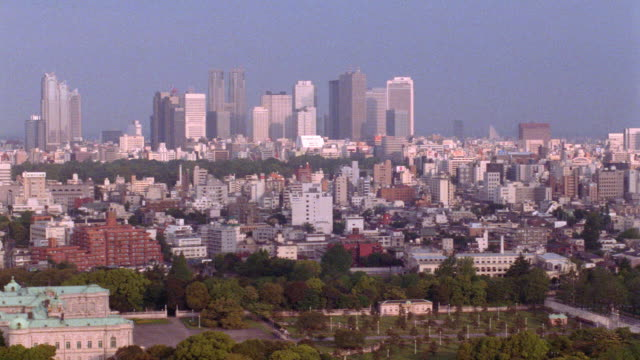 high angle wide shot pan of cityscape / tokyo - horizon over land stock videos & royalty-free footage