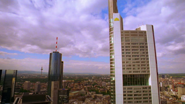 high angle wide shot pan clouds over skyscrapers in frankfurt skyline / germany - dresdner bank stock videos and b-roll footage