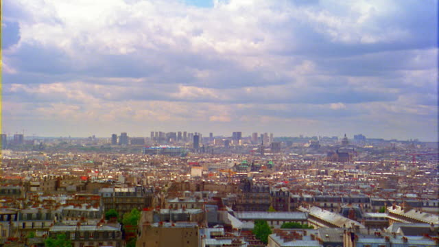high angle wide shot clouds rolling over cityscape / paris, france - 1993 stock videos & royalty-free footage