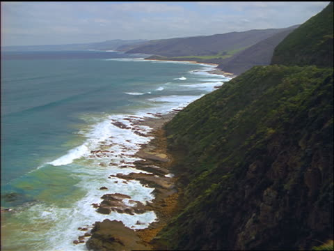 high angle wide shot coastline by great ocean road / port campbell national park, victoria, australia - port campbell national park stock videos & royalty-free footage