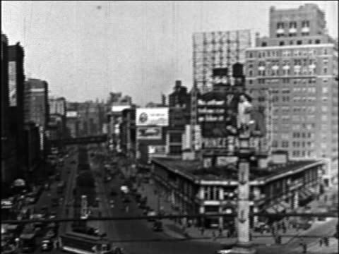 b/w 1926 high angle wide shot pan columbus circle / new york city / documentary - ブロードウェイ点の映像素材/bロール