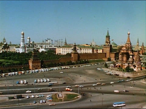 1967 high angle wide shot crane shot pan buildings and traffic / moscow - crane shot stock videos & royalty-free footage