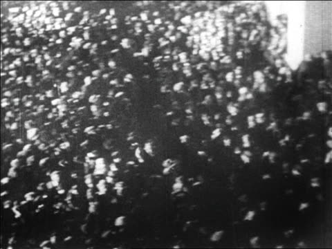 b/w 1927 high angle wide shot pan crowd at le bourget airfield at night waiting for lindbergh / paris / newsreel - 1927 stock videos & royalty-free footage