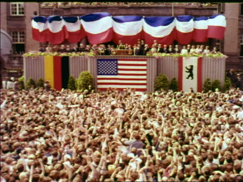 1963 high angle wide shot crowd cheering for president john kennedy at podium / west berlin / newsreel - john f. kennedy politik stock-videos und b-roll-filmmaterial