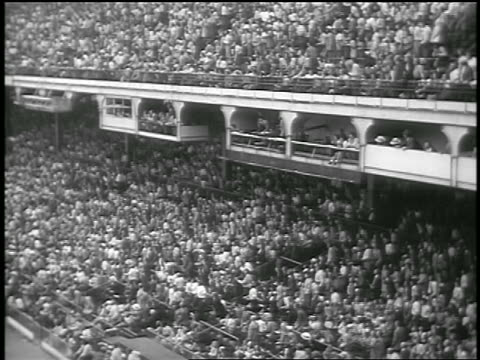 b/w 1947 high angle wide shot crowd in stands at ebbets field standing up / brooklyn ny / newsreel - ebbets field video stock e b–roll