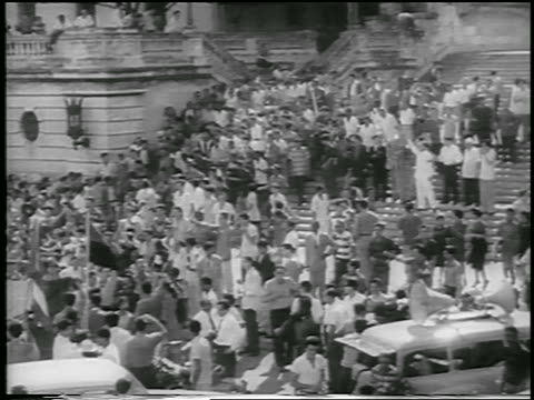 b/w 1959 high angle wide shot crowd on stairs in front of capitol building / postrevolution havana / newsreel - 1959 stock-videos und b-roll-filmmaterial