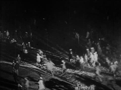 b/w 1927 high angle wide shot crowd running to see lindbergh / le bourget airfield paris / newsreel - 1927 stock videos & royalty-free footage