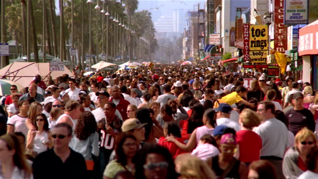 high angle wide shot crowd walking on promenade at venice beach / venice, los angeles, california - heatwave stock videos & royalty-free footage