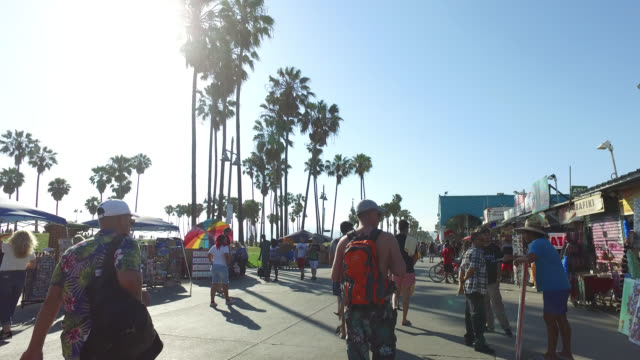 high angle wide shot crowd walking on promenade at venice beach - venice california stock videos & royalty-free footage
