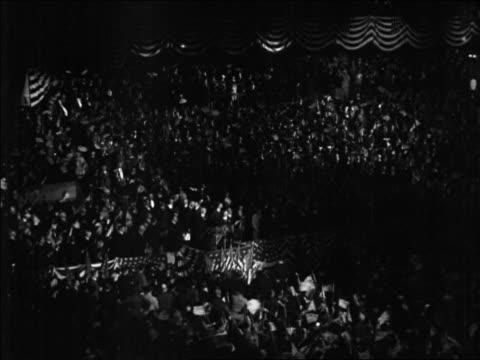 high angle wide shot crowd waving flags at republican national convention / kansas city / newsreel - 1928 stock videos & royalty-free footage