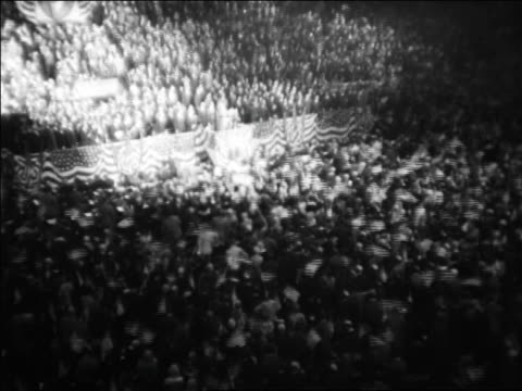 high angle wide shot crowd waving flags at republican national convention sits / kansas city / news. - 1928 stock videos & royalty-free footage