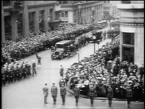 b/w 1923 high angle wide shot crowds on city street watch president harding's funeral procession / san francisco - 1923 stock videos & royalty-free footage