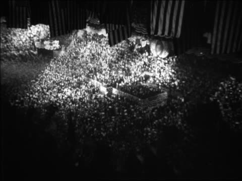 vidéos et rushes de b/w 1928 high angle wide shot crowds waving flags at republican national convention / newsreel - 1928